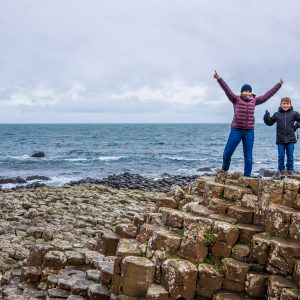 Mother and son at Giants causeway in autumn, Northern Ireland