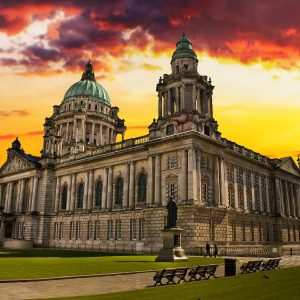 Beautiful Picture of City Hall in Belfast Northern Ireland during a colorful sunset.
